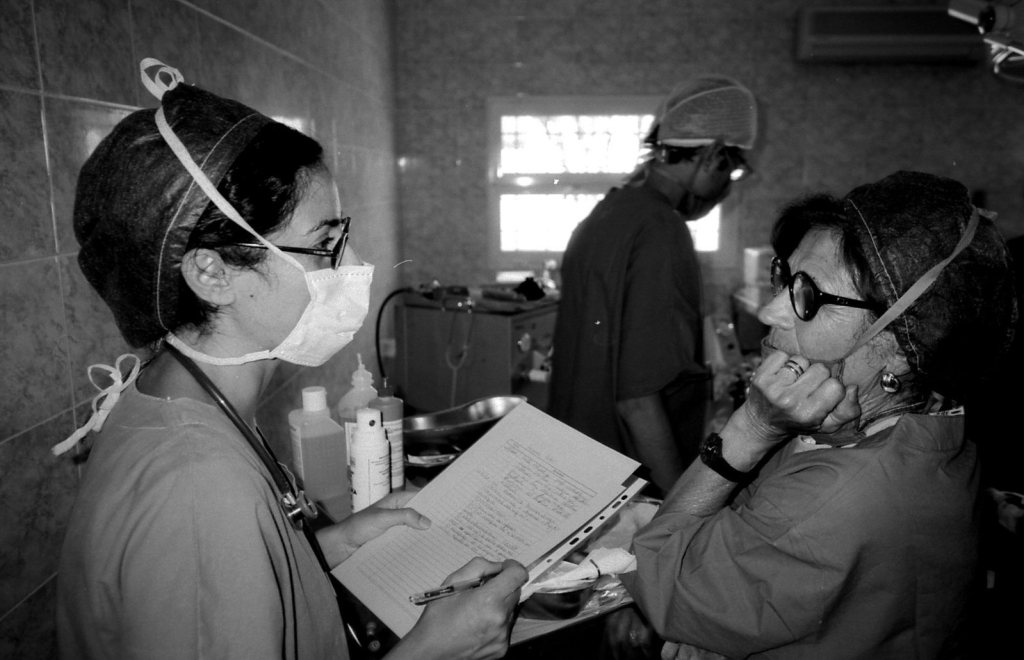 Doctor with COVID patient